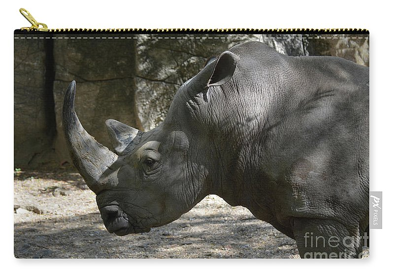Rhino Carry-all Pouch featuring the photograph Side Profile Of A Large Rhinoceros With Two Horns by DejaVu Designs