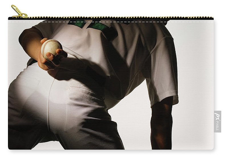 Three Quarter Length Carry-all Pouch featuring the photograph Silhouette Of Baseball Pitcher Holding by Pm Images