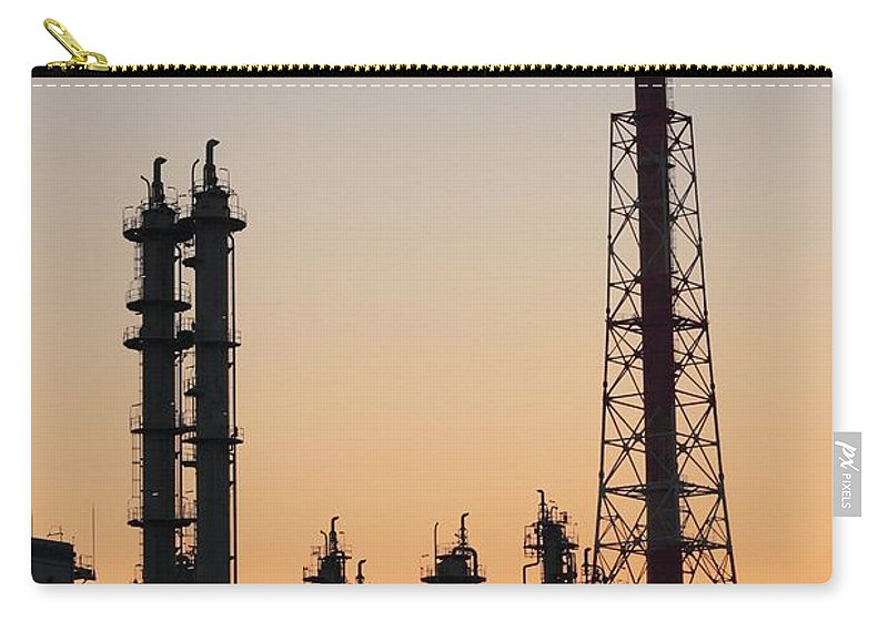 Built Structure Carry-all Pouch featuring the photograph Silhouette Of Petrochemical Plant by Hiro/amanaimagesrf