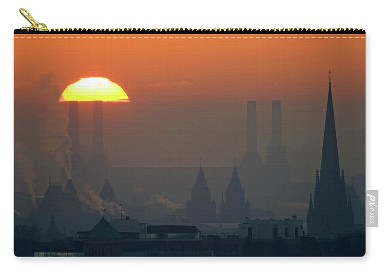 Tranquility Carry-all Pouch featuring the photograph Silhouettes Of Chimneys And Spires by James Burns