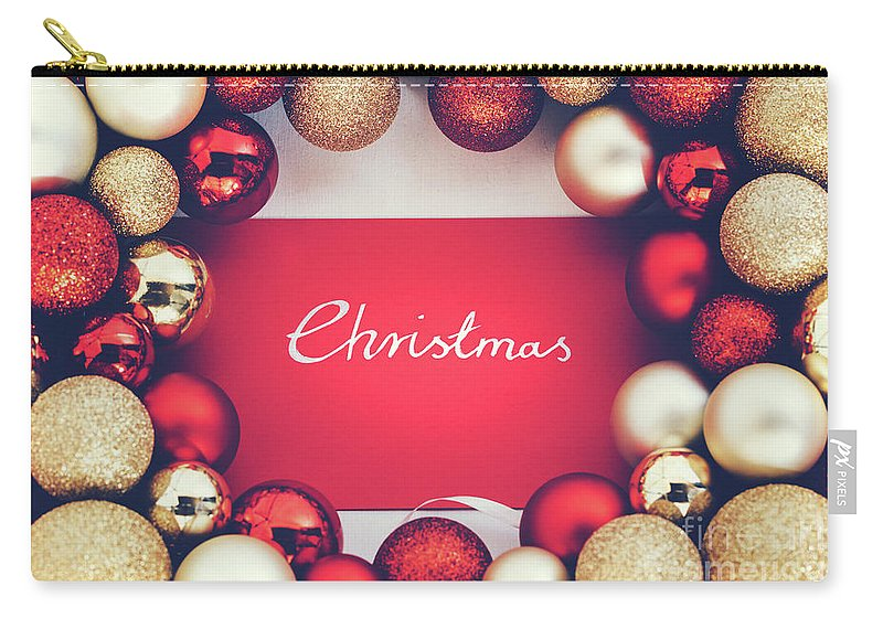 Christmas Carry-all Pouch featuring the photograph Silver Christmas Writing And Christmas Glass Balls. by Michal Bednarek