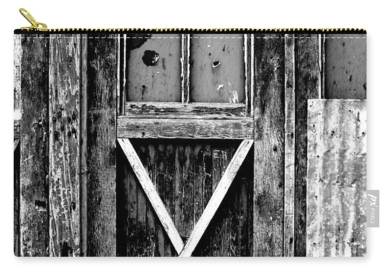 Black Color Carry-all Pouch featuring the photograph Sinclair Door by Herlordship