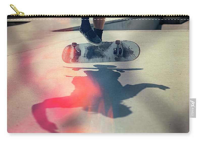 Cool Attitude Carry-all Pouch featuring the photograph Skateboarder Doing An Ollie by Devon Strong