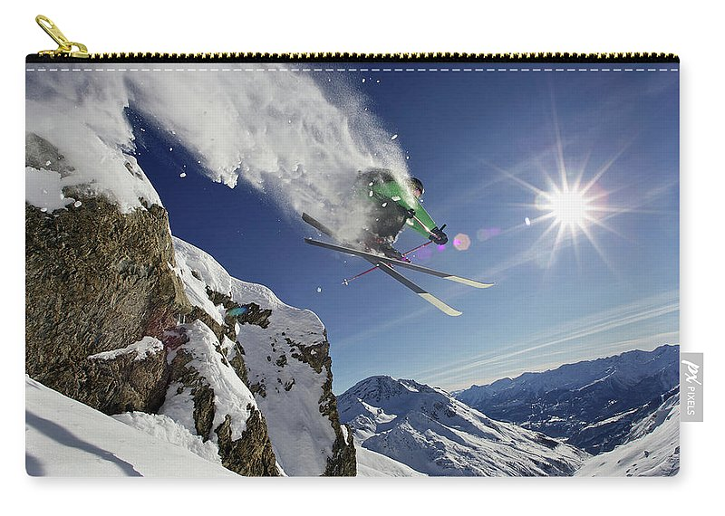 Young Men Carry-all Pouch featuring the photograph Skier In Midair On Snowy Mountain by Michael Truelove