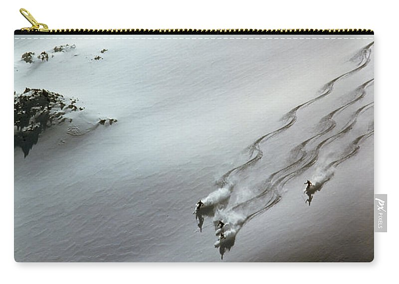Shadow Carry-all Pouch featuring the photograph Skier Moving Down In Snow On Slope by John P Kelly