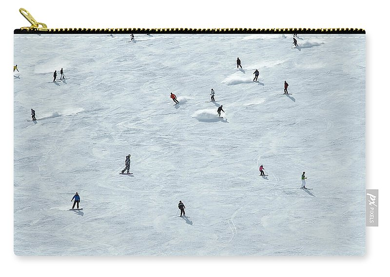 Skiing Carry-all Pouch featuring the photograph Skiing In Mayrhofen Austria by Mike Harrington