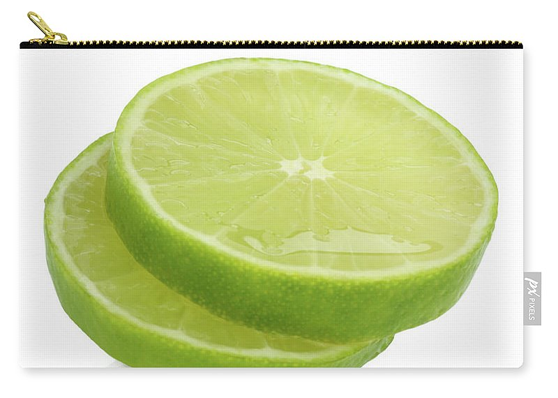 White Background Carry-all Pouch featuring the photograph Slices Of Fresh, Juicy, Freshly Cut Lime by Rosemary Calvert