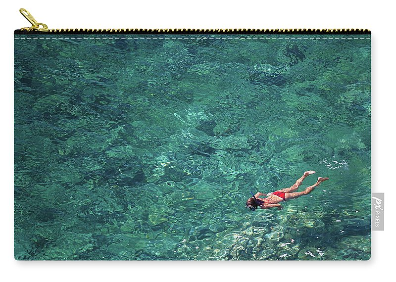 Recreational Pursuit Carry-all Pouch featuring the photograph Snorkeling In The Mediterranean Sea by Photovideostock
