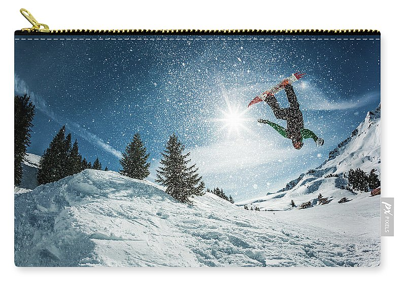 People Carry-all Pouch featuring the photograph Snowboarder Doing A Backflip With Snow by © Francois Marclay