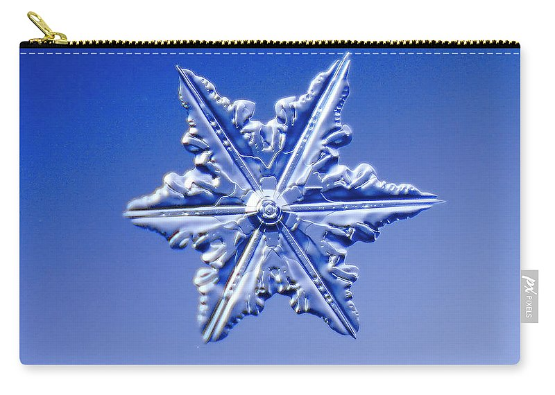 Snow Carry-all Pouch featuring the photograph Snowflake On Blue Background by Fwwidall