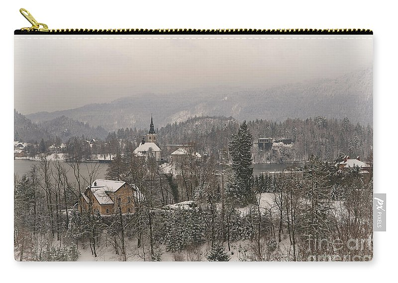 Christmas Carry-all Pouch featuring the photograph Snowy Bled In Slovenia by MSVRVisual Rawshutterbug