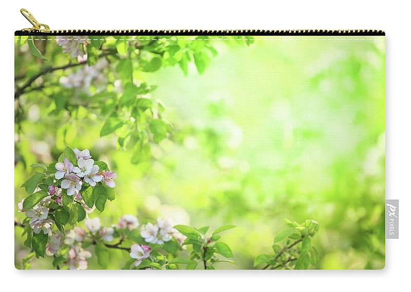 Grass Carry-all Pouch featuring the photograph Spring Flowers Blooming Orchard - by Konradlew