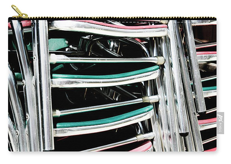 Stack Carry-all Pouch featuring the photograph Stack of Chrome Chairs by Marilyn Hunt