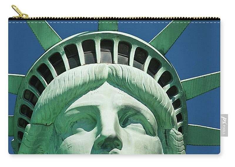 Crown Carry-all Pouch featuring the photograph Statue Of Liberty by Tetra Images