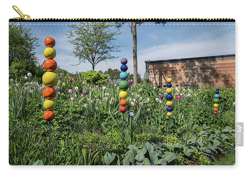 Color Carry-all Pouch featuring the photograph Sticks With Colorful Balls In A Garden by Stefan Rotter