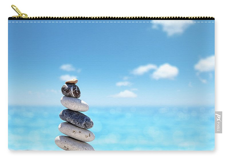 Water's Edge Carry-all Pouch featuring the photograph Stone Balance On Beach by Imagedepotpro