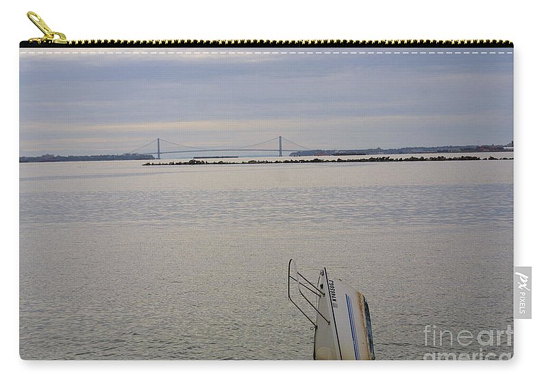 Sunken Sailboat And Bridge Carry-all Pouch featuring the photograph Sunken Sailboat In The Bay by Darren Dwayne Frazier