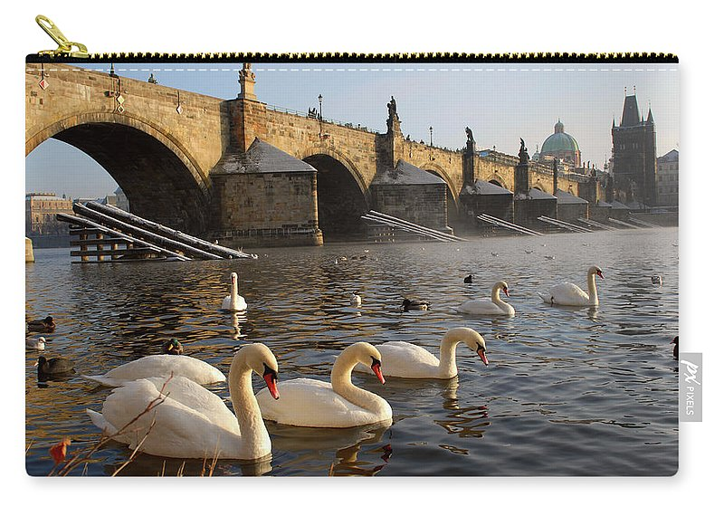 Arch Carry-all Pouch featuring the photograph Swans And Charles Bridge by Dibrova