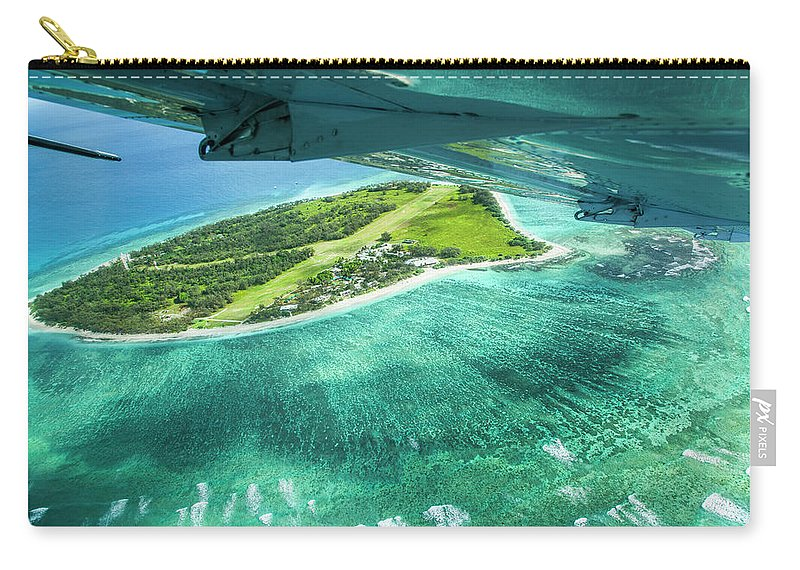 Grass Carry-all Pouch featuring the photograph Taking Off From Great Barrier Reef by Nick