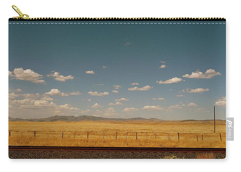 Tranquility Carry-all Pouch featuring the photograph Texan Desert Landscape And Rail Tracks by Papilio