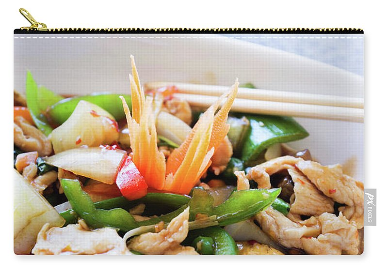 Chicken Meat Carry-all Pouch featuring the photograph Thai Basil Chicken Dish And Bowl Of by Rapideye