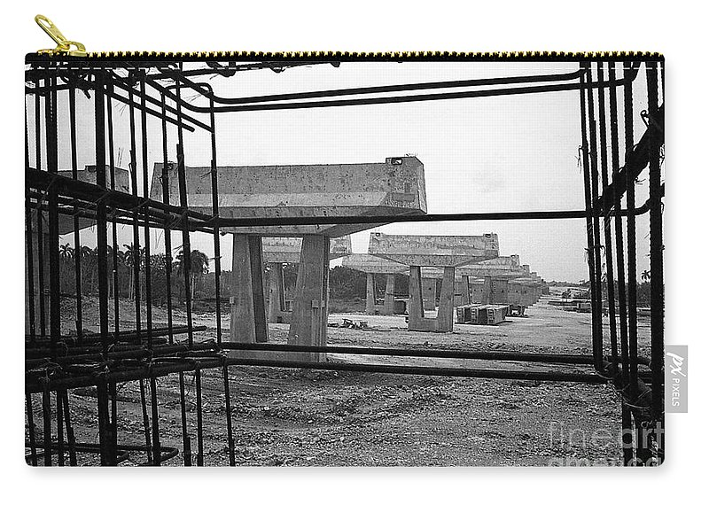 Hidden Strength Of New Stone Carry-all Pouch featuring the photograph The Iron Substructure by Venancio Diaz
