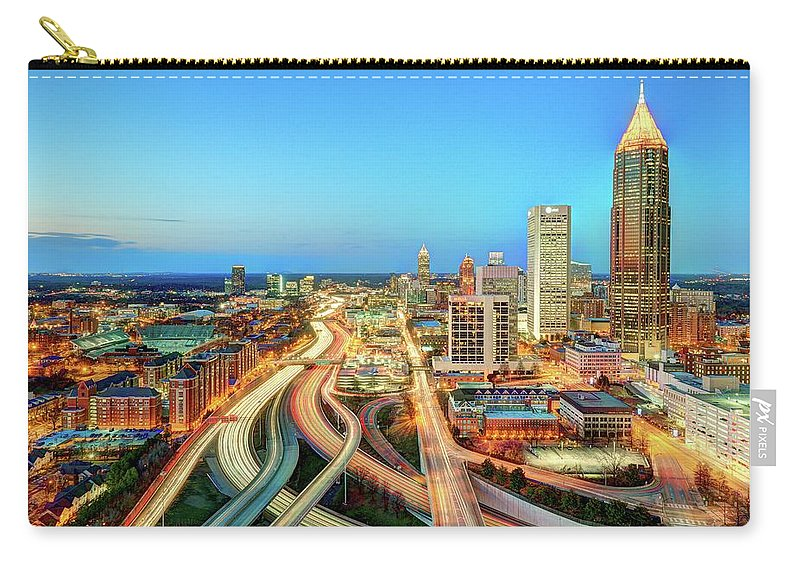Atlanta Carry-all Pouch featuring the photograph The Lifeblood Of Atlanta by Photography By Steve Kelley Aka Mudpig