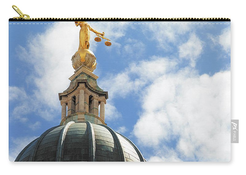 Statue Carry-all Pouch featuring the photograph The Old Bailey, Central Criminal Court by Peter Dazeley