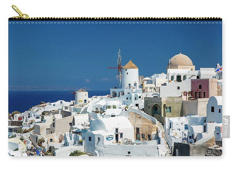 Greek Culture Carry-all Pouch featuring the photograph The Small Greek Village Of Oia by Sylvain Sonnet