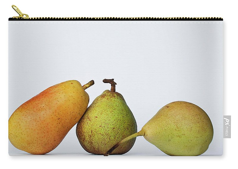 Healthy Eating Carry-all Pouch featuring the photograph Three Diferent Pears Isolated On Grey by Irantzu Arbaizagoitia Photography