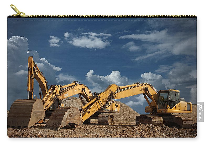 Working Carry-all Pouch featuring the photograph Three Excavators At Construction Site by Narvikk