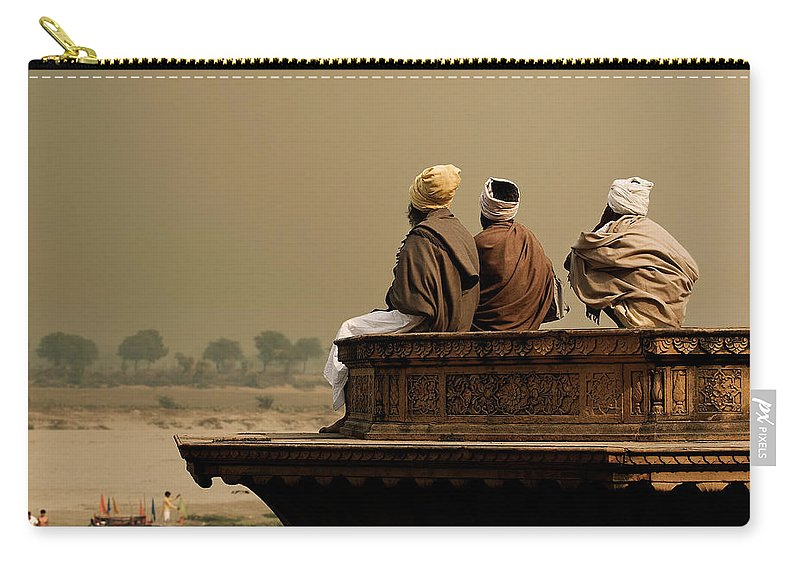Water's Edge Carry-all Pouch featuring the photograph Three Sadhus Meditating By The Yamuna by Globalstock
