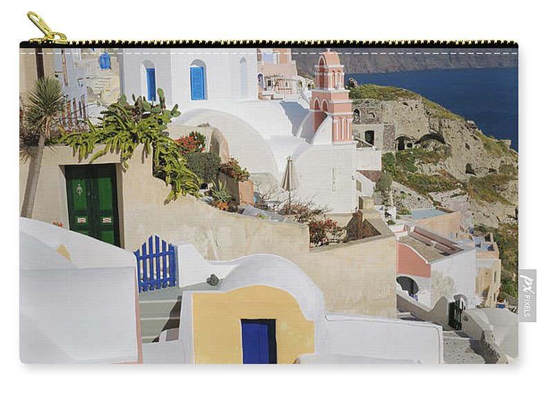 Greek Culture Carry-all Pouch featuring the photograph Traditional Greek Houses And Curch by Martin Ruegner