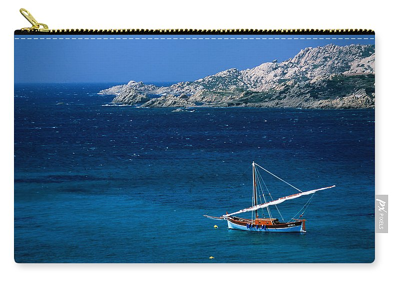 Sailboat Carry-all Pouch featuring the photograph Traditional Sailboat On Rocky Coast Of by Dallas Stribley