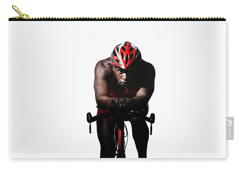 Three Quarter Length Carry-all Pouch featuring the photograph Triathlete Riding On Bicycle by Paul Taylor