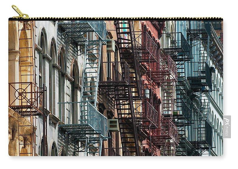 Downtown District Carry-all Pouch featuring the photograph Tribeca Fire Escapes by Joseph O. Holmes / Portfolio.streetnine.com