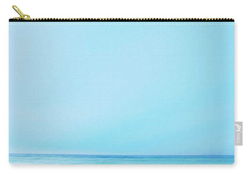 Dawn Carry-all Pouch featuring the photograph Two Beach Chairs On Tropical Beach At by Thomas Barwick