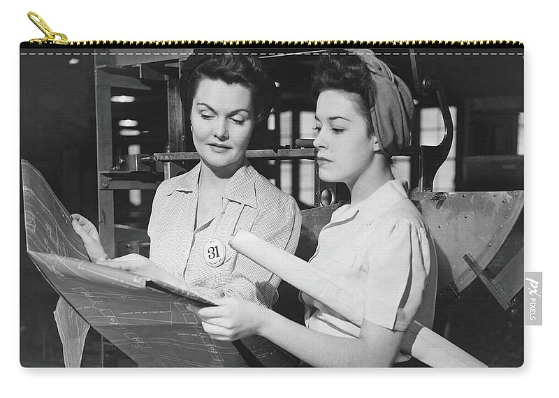 Plan Carry-all Pouch featuring the photograph Two Women In Workshop Looking At by George Marks