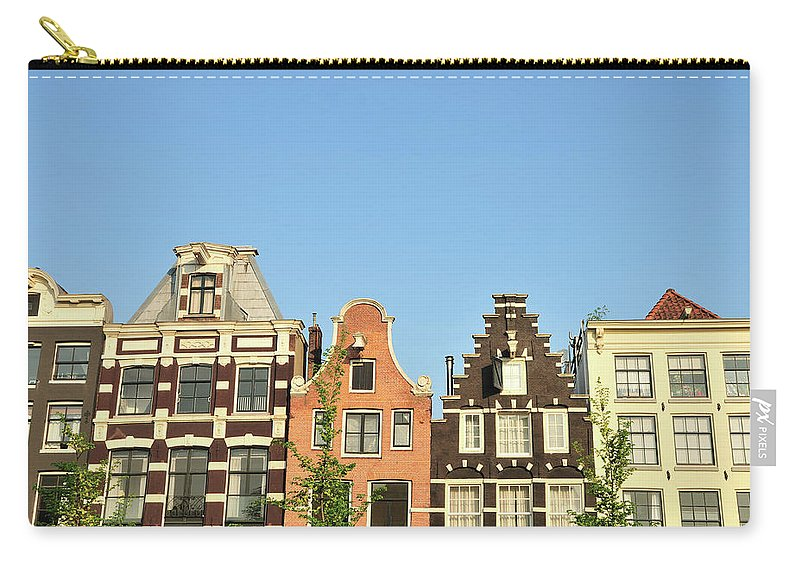 In A Row Carry-all Pouch featuring the photograph Typical Canal Houses, Amsterdam, The by Gorazdbertalanic