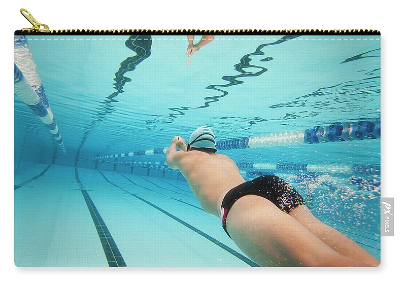 Underwater Carry-all Pouch featuring the photograph Underwater Swimmer by David Freund