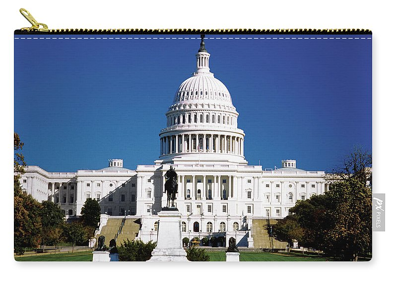 Statue Carry-all Pouch featuring the photograph U.s. Capitol Building In Washington by Medioimages/photodisc