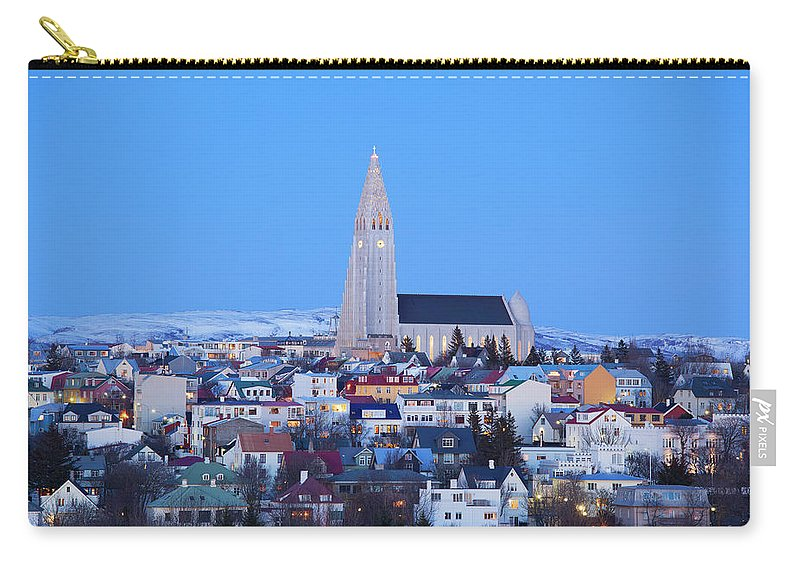 Snow Carry-all Pouch featuring the photograph View Of Hallgrimskirkja Church by Travelpix Ltd