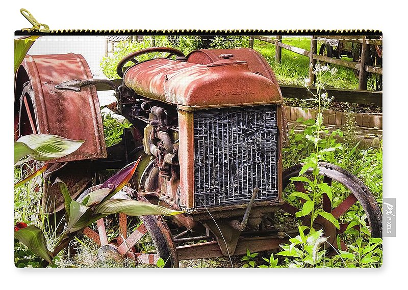 Red Carry-all Pouch featuring the photograph Vintage Rusted Tractor by Marge Sudol