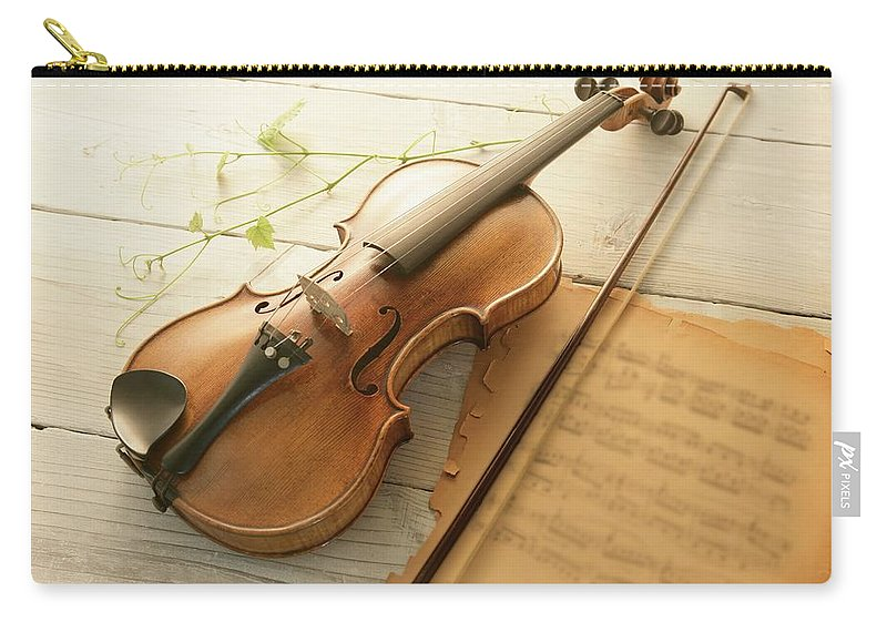 Sheet Music Carry-all Pouch featuring the photograph Violin And Music Sheet by Image Work/amanaimagesrf