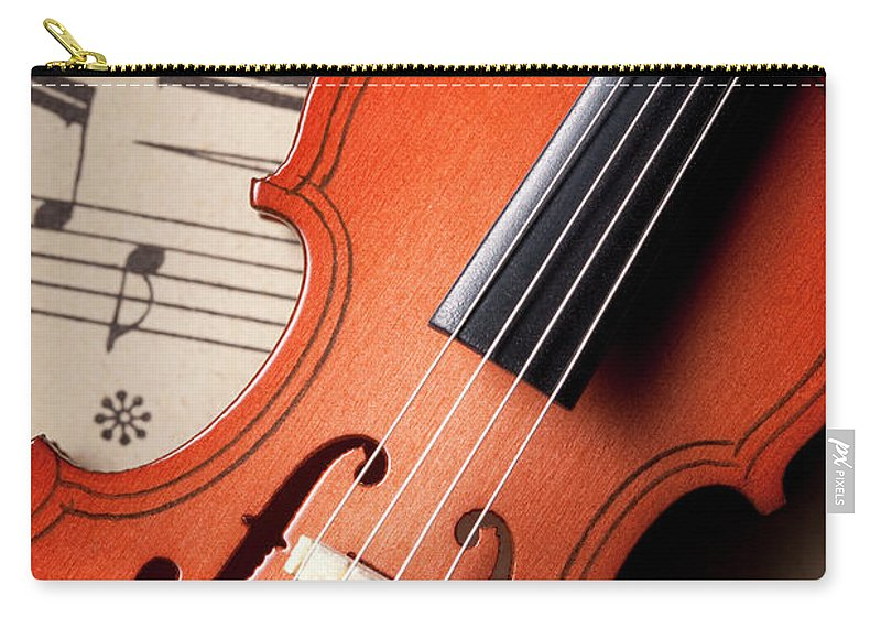 Sheet Music Carry-all Pouch featuring the photograph Violin On Sheet Music by Malerapaso