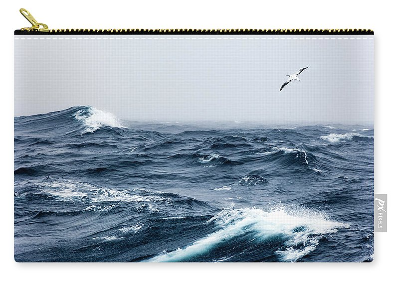 Wandering Albatross Carry-all Pouch featuring the photograph Wandering Albatross In Flight Over A by Mike Hill