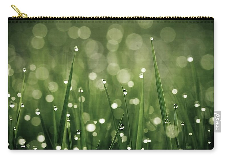 Grass Carry-all Pouch featuring the photograph Water Drops On Grass by Florence Barreau