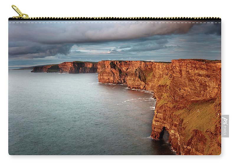 Scenics Carry-all Pouch featuring the photograph Waves Washing Up On Rocky Cliffs by George Karbus Photography