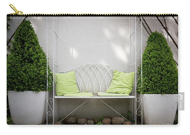Bench Carry-all Pouch featuring the photograph White Bench Made Of Iron With Two Green Bushes On The Side by Stefan Rotter