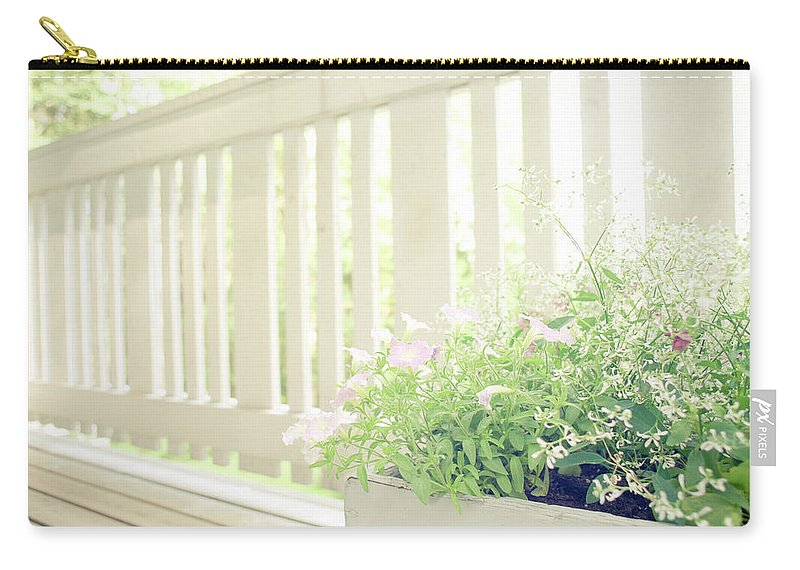 Outdoors Carry-all Pouch featuring the photograph White Fence And Flowers by Photographer Mikael Nyberg